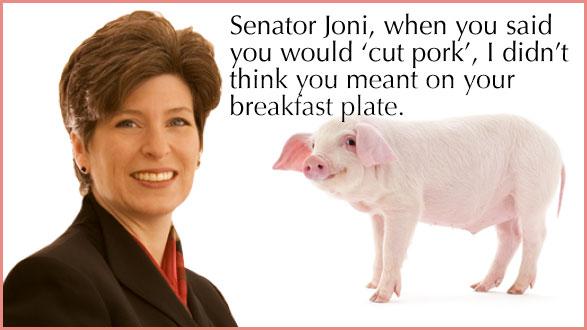 Senator Joni Ernst with pig ready to be eaten