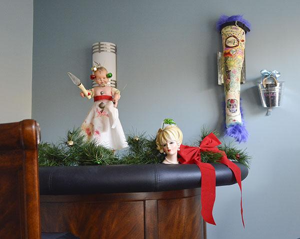 creative leg cast art in a art deco bar area with dead baby doll art sculputre.
